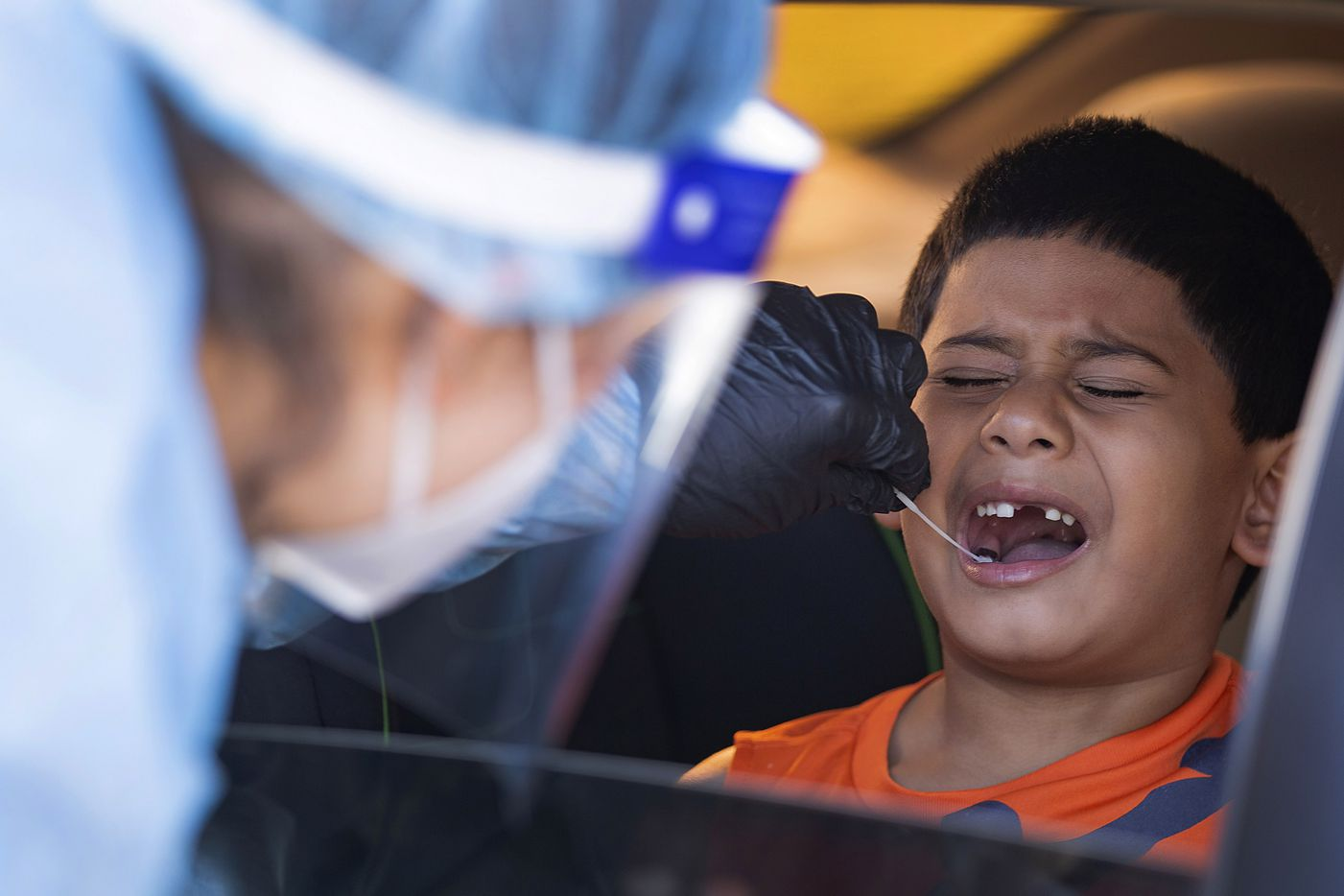Elizabeth Osborn, medical assistant at WellHealth, swabs Josiah Soto's (4) mouth for COVID at Sharing Life Community Outreach, a nonprofit that provides food and other resources, in Mesquite on Tuesday, Oct. 20, 2020. The nonprofit has partnered with GoGetTested to offer free testing.