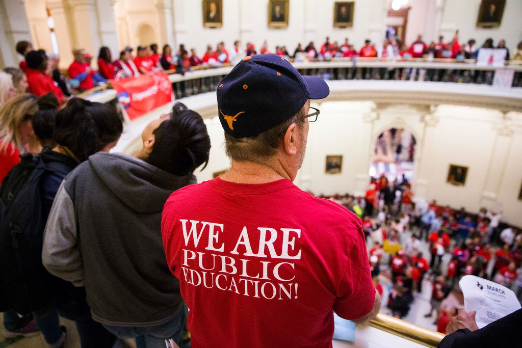 Retired teacher Richard Cronshey of San Marcos, Texas, watches and chants from the second floor of the rotunda during the Texas Public Education Rally on March 11, 2019, at the Texas capitol in Austin.