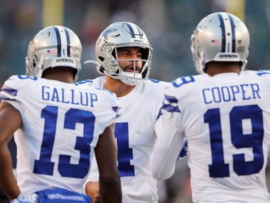 Dallas Cowboys quarterback Dak Prescott (4) talks with Dallas Cowboys wide receiver Michael Gallup (13) and Dallas Cowboys wide receiver Amari Cooper (19) during warmups before a game against the Philadelphia Eagles at Lincoln Financial Field in Philadelphia on Sunday, December 22, 2019. (Vernon Bryant/The Dallas Morning News)