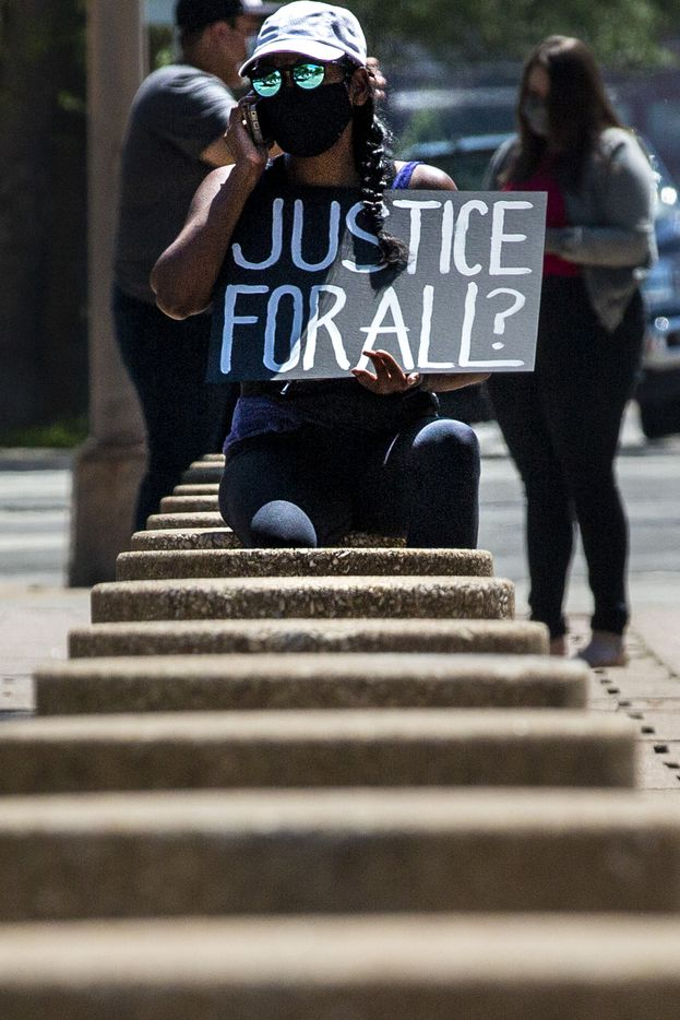 Shalini Maharaj joins protesters in a silent demonstration at Dallas City Hall to denounce police brutality and systemic racism in Dallas on Thursday, June 4, 2020. The demonstration took place on the seventh day of organized protests in response to the recent deaths of George Floyd in Minneapolis and Breonna Taylor in Louisville.