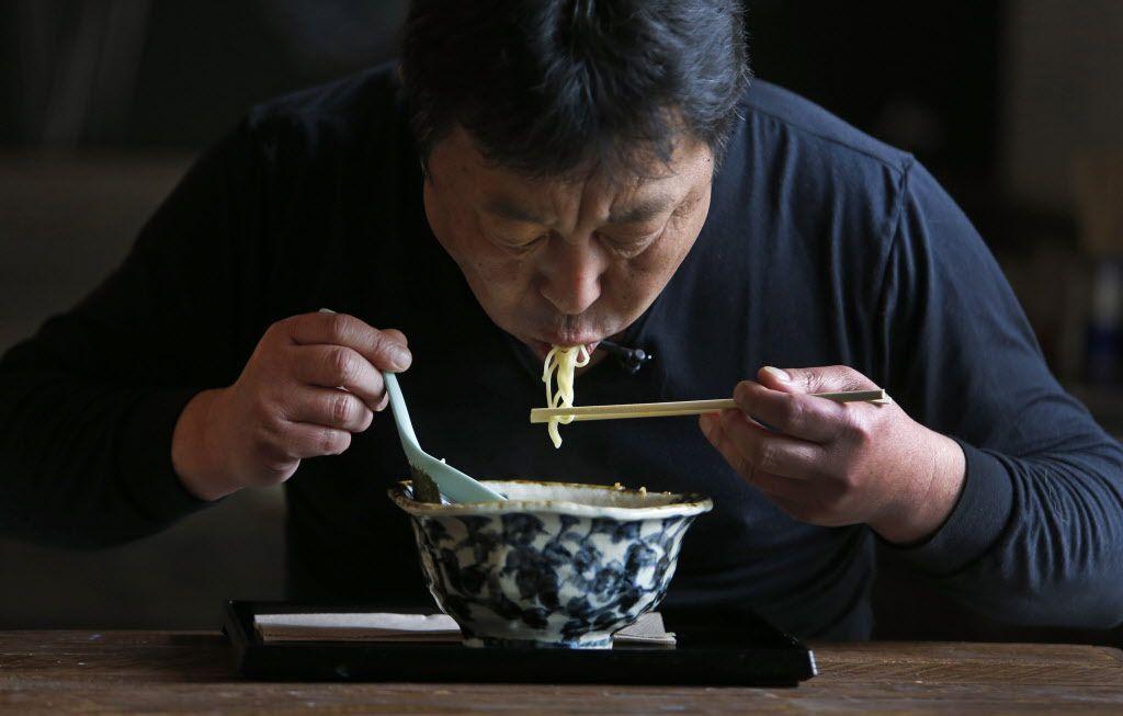 Chef Teiichi Sakurai demonstrates how to eat ramen, at the restaurant Ten at Sylvan 30 in Dallas, photographed on Tuesday, April 21, 2015.