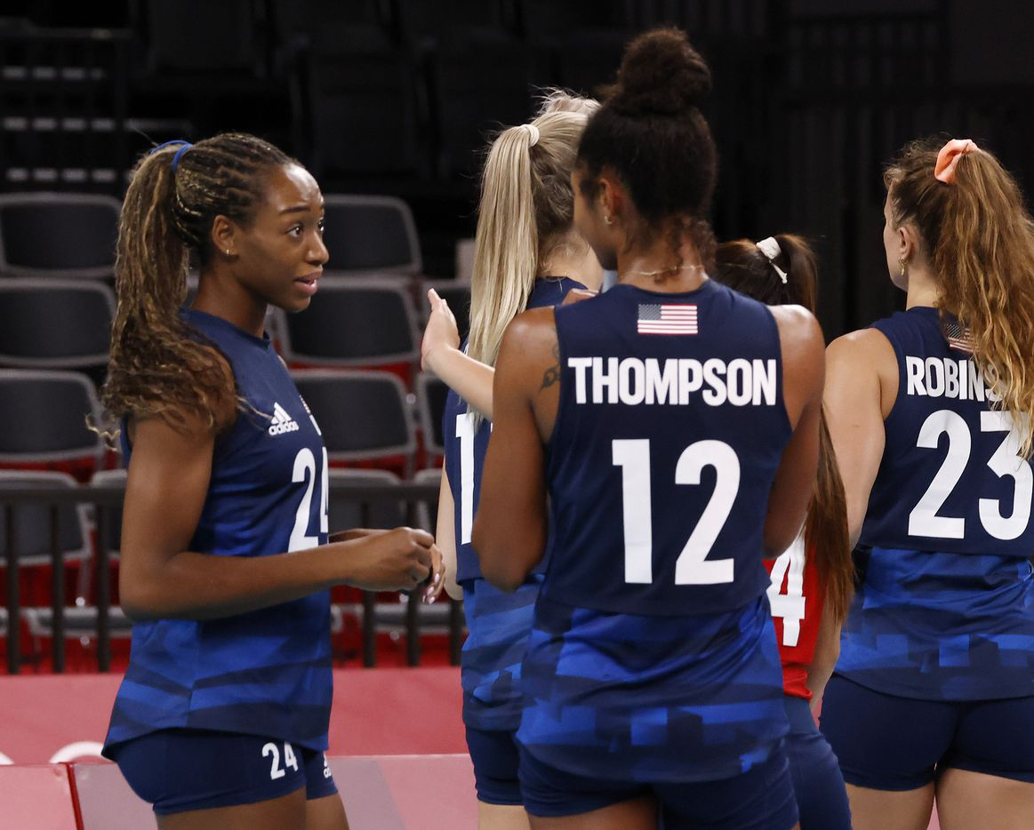 USA's Chiaka Ogbogu (24) talks to Jordan Thompson (12) after the team defeated Argentina in a women's volleyball game during the postponed 2020 Tokyo Olympics at Ariake Arena on Sunday, July 25, 2021, in Tokyo, Japan. USA defeated Argentina 3-0 (25-20, 25-19, 25-20). (Vernon Bryant/The Dallas Morning News)