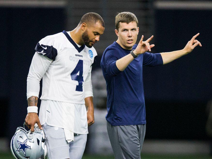 Dallas Cowboys offensive coordinator Kellen Moore talks to quarterback Dak Prescott (4) during a Dallas Cowboys OTA practice on Wednesday, May 29, 2019 at The Star in Frisco. (Ashley Landis/The Dallas Morning News)