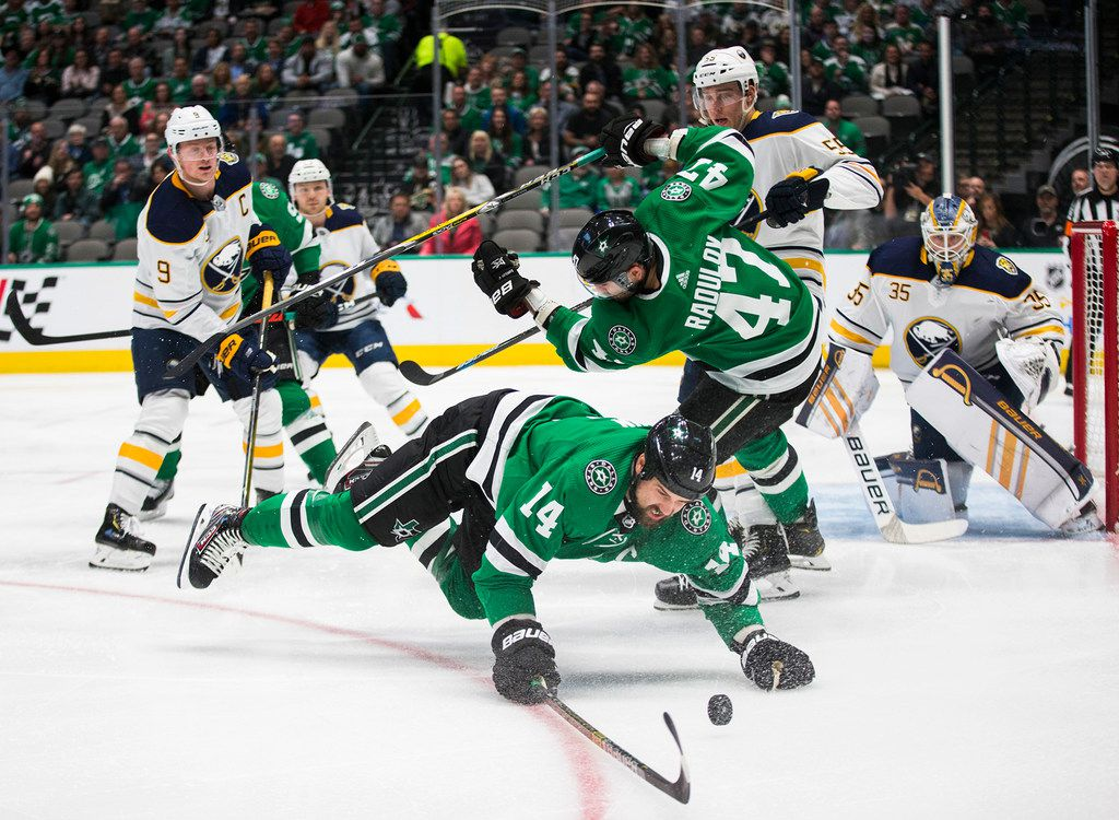 The Dallas Stars' Jamie Benn dives for the puck during the first period against the Buffalo Sabres on Jan. 16, 2020, at American Airlines Center in Dallas.