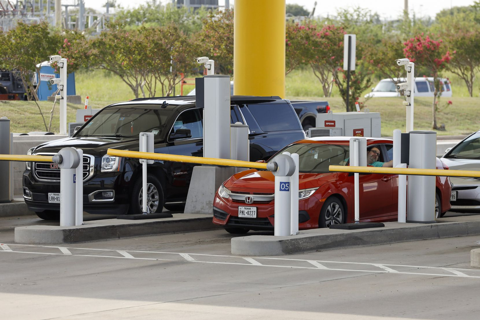 Drivers collect tickets at Dallas Fort Worth International Airport's south entrance on Friday, Sept. 3, 2021.