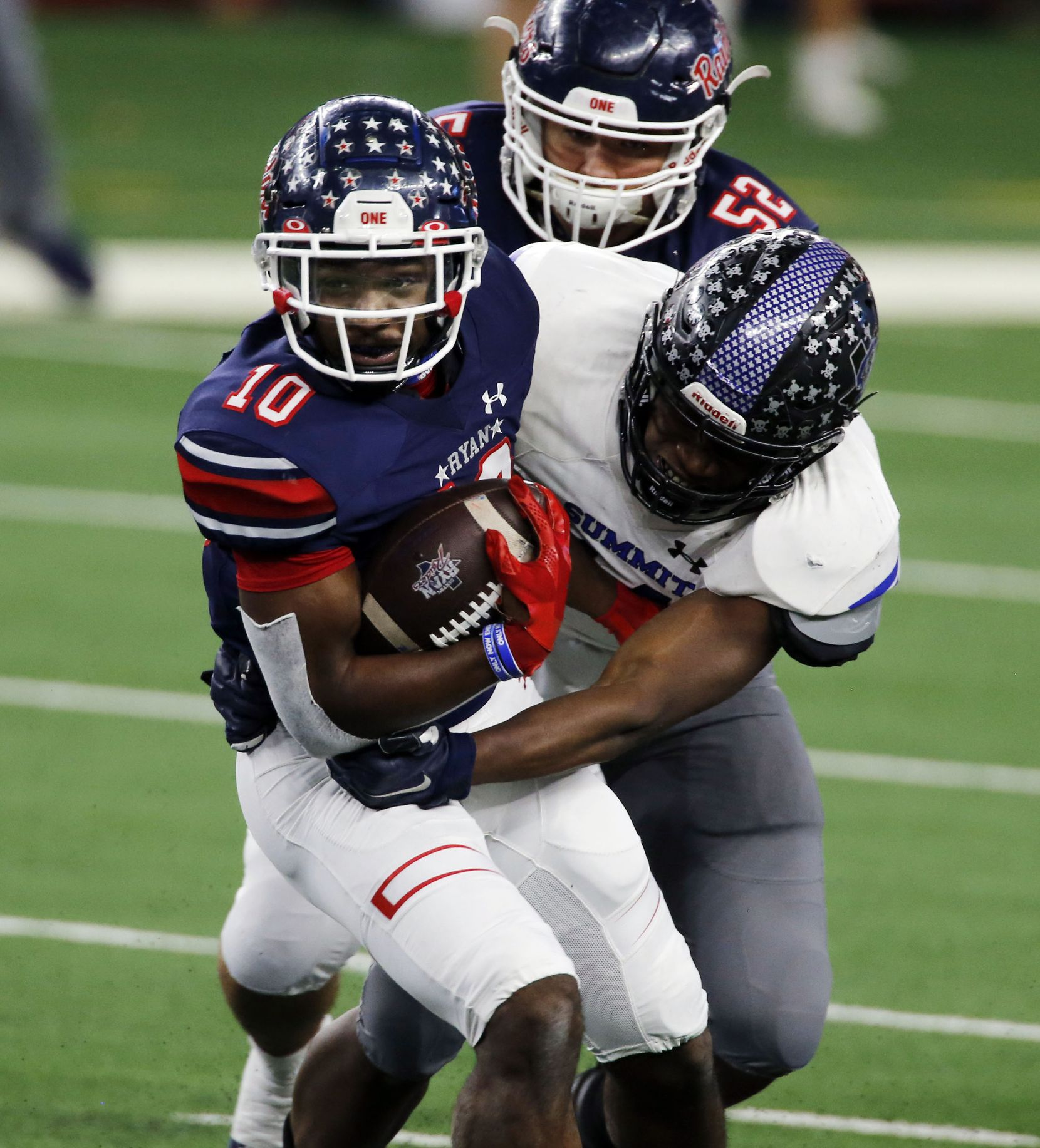 Denton Ryan's Kalib Hicks (10) picks up a couple of yards under pressure during the first half of the Class 5A Division I state semifinal football playoff game against Mansfield Summit High at AT&T Stadium in Arlington on Friday, January 8, 2021. (John F. Rhodes / Special Contributor)