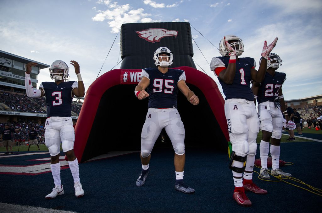 Allen football players cheer on their team before a high school football game between Allen and Cedar Hill on Friday, August 30, 2019 at Eagle Stadium in Allen. (Ashley Landis/The Dallas Morning News)