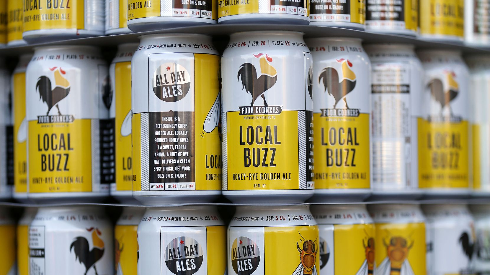 Empty cans for Four Corners' Local Buzz brewed as an Golden Ale style beer wait to be filled at Four Corners Brewing Co.