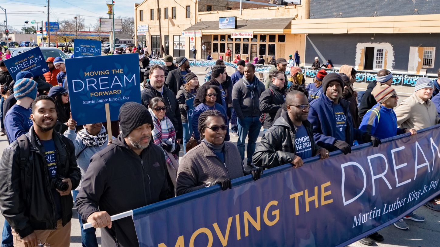 USAA workers participate in a Dallas' MLK Parade.