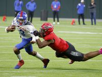Duncanville quarterback Soloman James (3), gets tackled by Cedar Hill's Harvey Dyson III, during a high school football game in Arlington, Texas on Friday, Oct. 22, 2021. (Michael Ainsworth/Special Contributor)