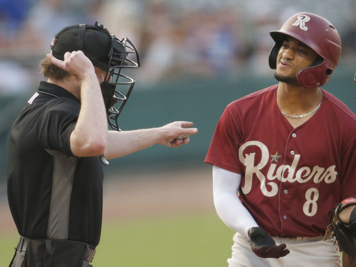 Frisco RoughRiders outfielder Bubba Thompson (8) reacts after he was called out on strikes by home plate umpire Darius Ghani to strand a bases loaded threat to end the bottom of the 3rd inning of play against San Antonio. The two teams played their minor league baseball game at Riders Field in Frisco on June 22, 2021 (Steve Hamm/ Special Contributor)