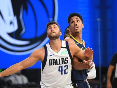 Orlando, FL - JULY 26: Maxi Kleber #42 of the Dallas Mavericks and Malcolm Brogdon #7 of the Indiana Pacers fights for position to grab the rebound during a scrimmage on July 26, 2020 at HP Field House at ESPN Wide World of Sports in Orlando, Florida. NOTE TO USER: User expressly acknowledges and agrees that, by downloading and/or using this Photograph, user is consenting to the terms and conditions of the Getty Images License Agreement. Mandatory Copyright Notice: Copyright 2020 NBAE