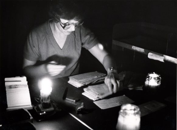 Dallas Republic Bank employee Arlene Huppert continued working with the aid of candles.