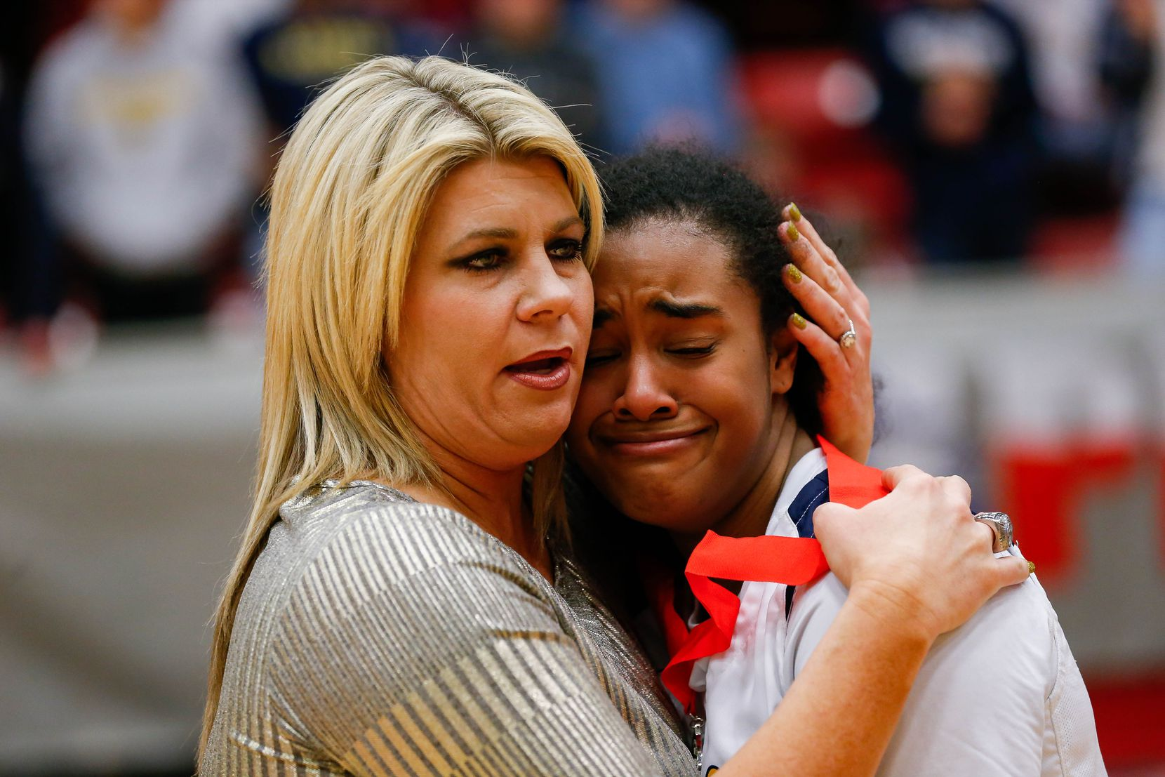 Plano Prestonwood Christian's Bria Stephens (24) hugs coach Holly Mulligan after losing a TAPPS Class 6A girls basketball state championship game against the Village School on Feb. 28, 2020 in West. Prestonwood lost 75-48.