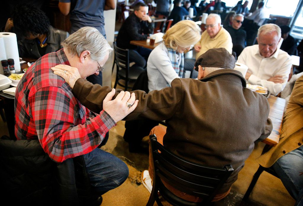 Jack McNairy of Plano (left) and Michael Signoretto of Dallas prayed during Tuesday's Bible study session at Smokey John's Bar-B-Que & Home Cooking in Dallas.