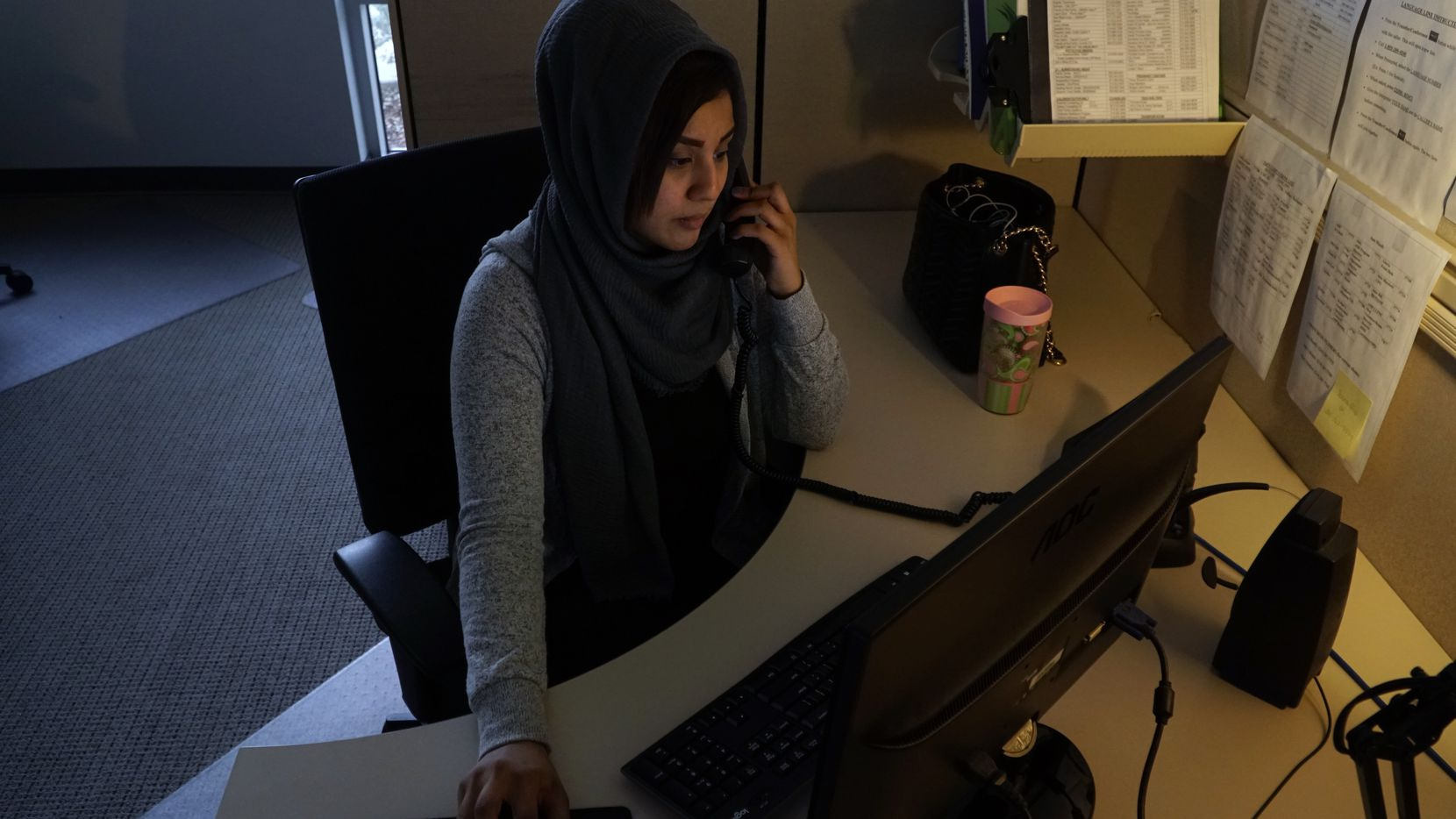 A hotline crisis counselor answers a call at the offices of The Family Place in Dallas in this November 2019 file photo.