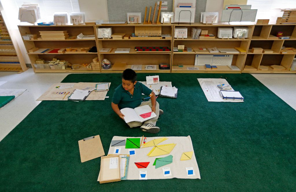 Second-grader Andres Tovar, 7, works on his classwork during a lower elementary dual language class at Mata Montessori in Dallas, Friday, April 28, 2017.