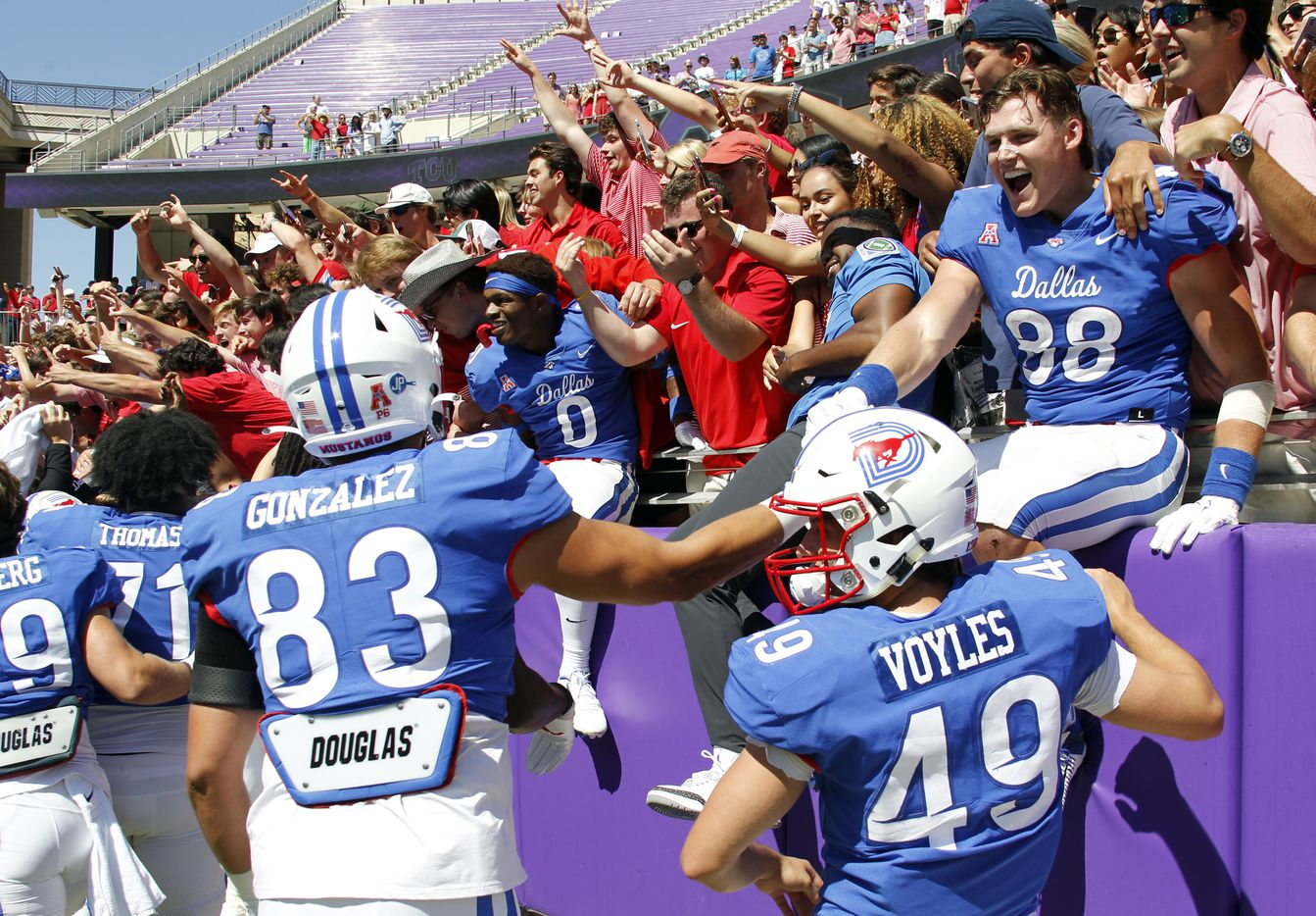 SMU Mustangs players celebrate with fans following their 42-34 victory over TCU. The two teams played their NCAA football game at Amon G. Carter Stadium on the campus of TCU in Fort Worth on September 25, 2021. (Steve Hamm/ Special Contributor)