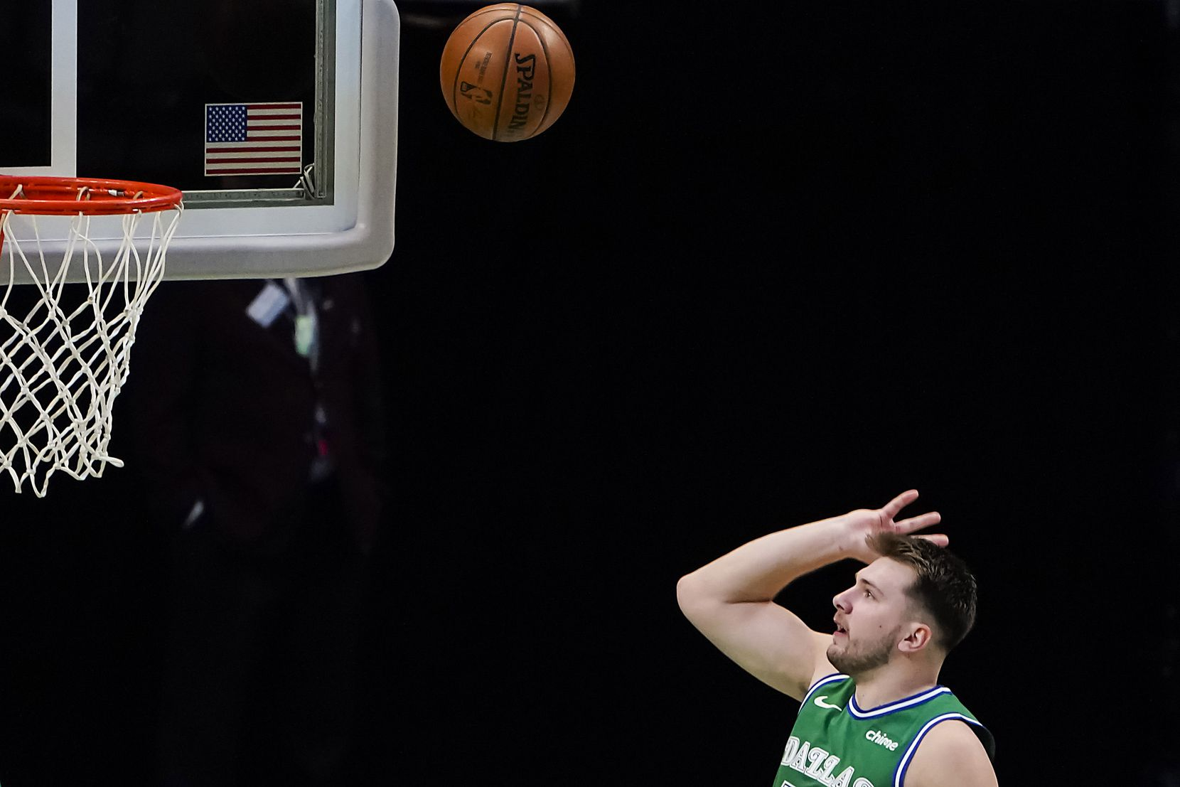 Dallas Mavericks guard Luka Doncic (77) puts up a shot during the first quarter of an NBA basketball game against the LA Clippers at American Airlines Center on Wednesday, March 17, 2021, in Dallas.