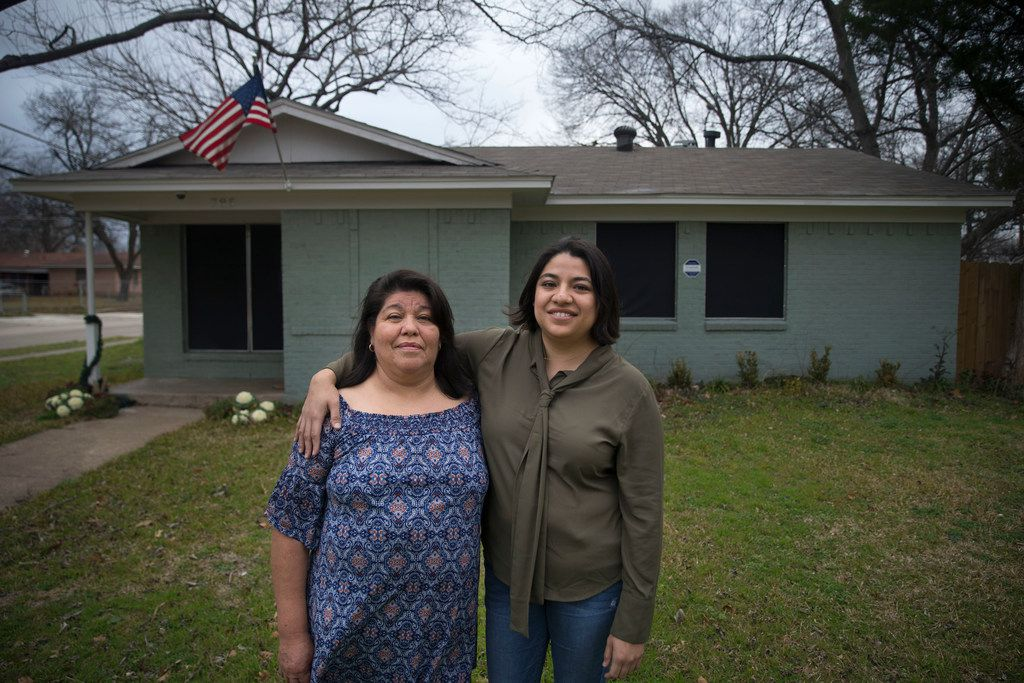 Roselia Soto, 59, left, and her daughter, Nora Soto, 33, pose for a portrait in front of Roselia's home in Dallas on Saturday, February 2, 2019.