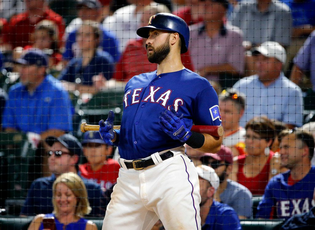 Texas Rangers batter Joey Gallo (13) stretches in the batting circle during the seventh inning against the Houston Astros at Globe Life Park in Arlington, Texas, Thursday, July 11, 2019.  (Tom Fox/The Dallas Morning News)