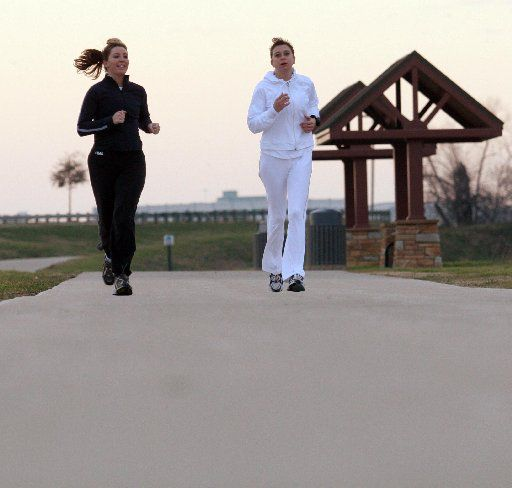 Runners jog along Irving's Campion Trail, which will soon connect to the city's downtown.