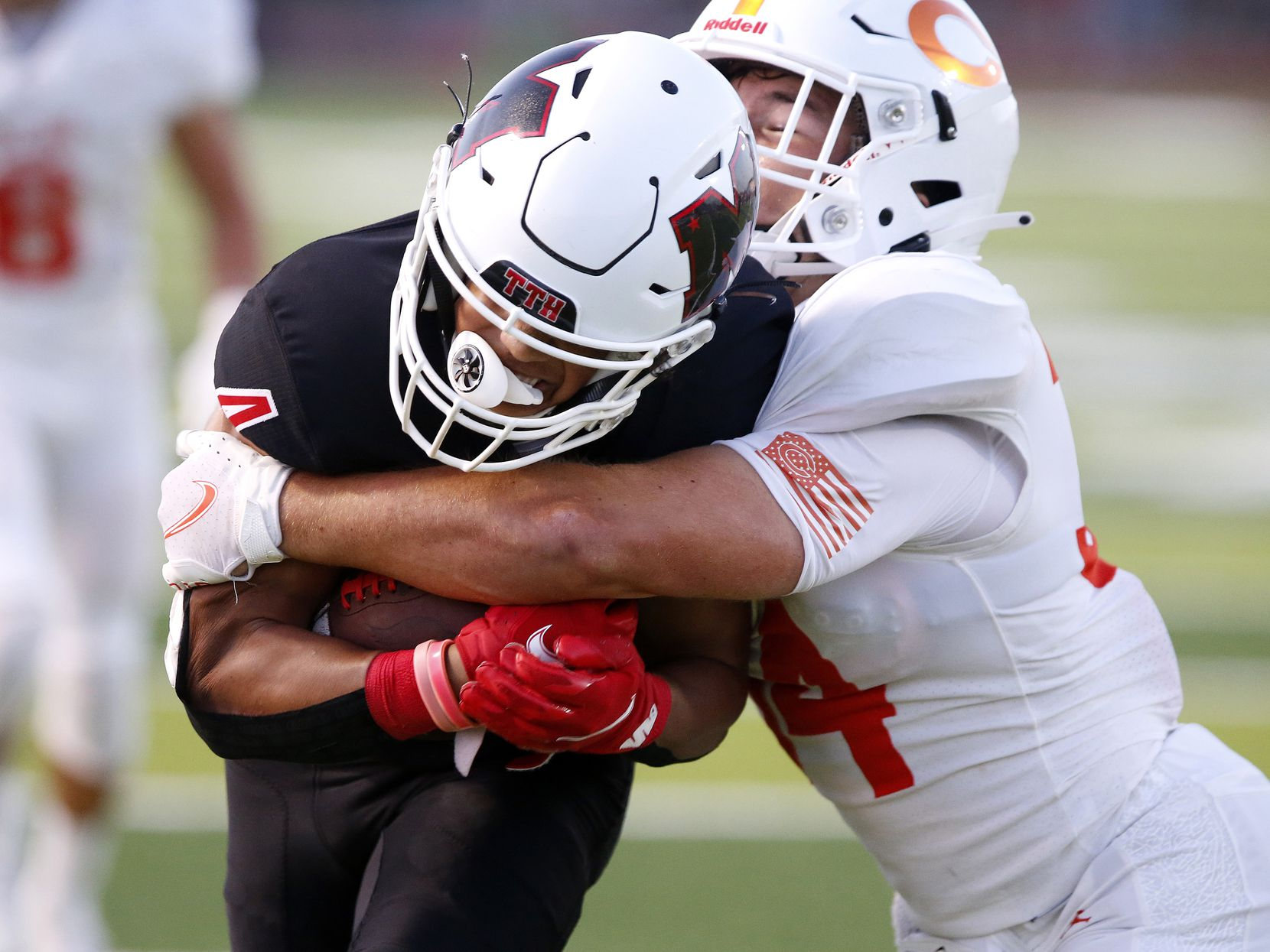 Melissa High School wide receiver Jayvon Smith (4) is tackled by Celina High School outside linebacker Zach Veverka (34) during the first half as Melissa High School hosted Celina High School at Cardinal Field in Melissa on Friday night, August 27, 2021. (Stewart F. House/Special Contributor)