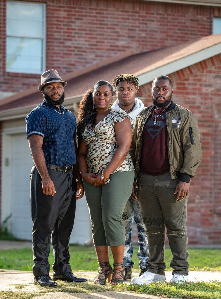Sammie Anderson (second from left) poses with her sons Sam Bible, 18 (left), Ty Anderson, 15 (third from left), and Grant Bible, 20, at their home in DeSoto.