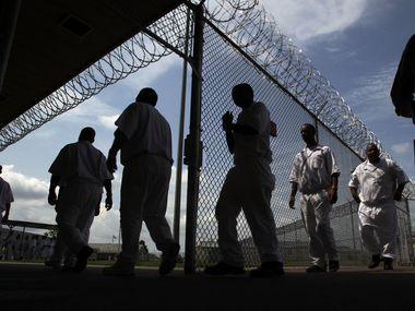 A photo taken July 16, 2014, shows inmates walking to the Chow Hall at the L.V. Hightower Unit in Dayton. Hightower is one of the many state-run jails and prisons that does not have air conditioning installed in inmate housing areas. (AP Photo/Houston Chronicle, Mayra Beltran)