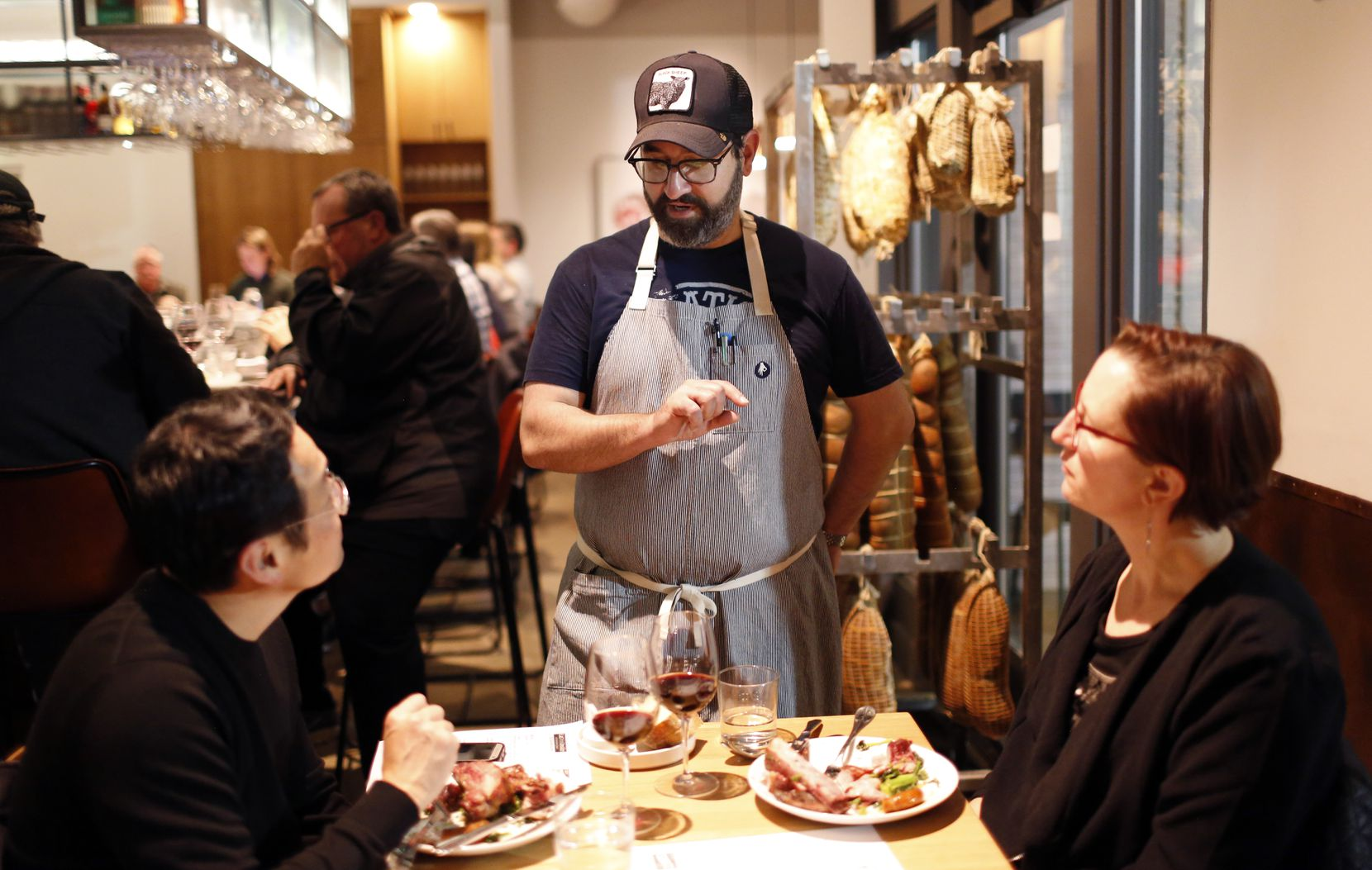 Chef David Uygur talks to diners at Macellaio in 2018.