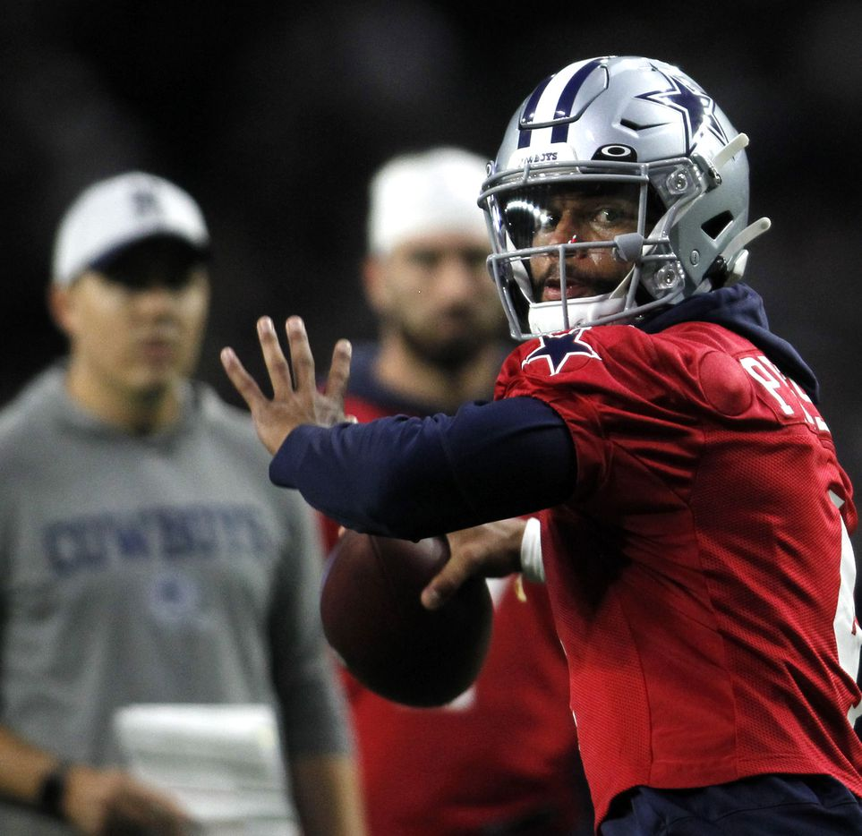 Dallas Cowboys quarterback Dak Prescott (4) prepares to launch a pass downfield during a team practice session. The Cowboys conducted their final public football practice session inside The Star at the Ford Center in Frisco on August 28, 2021. (Steve Hamm/ Special Contributor)