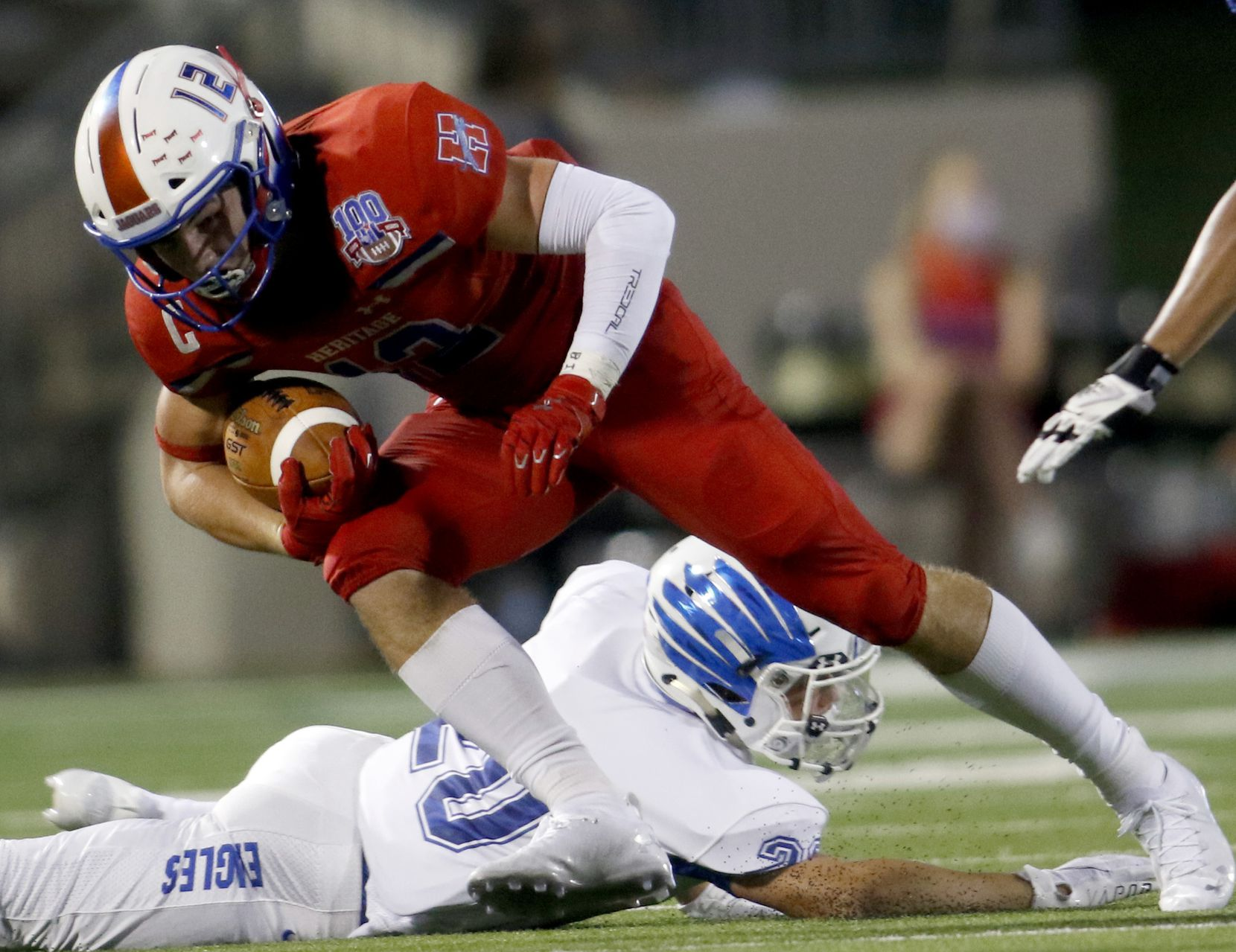 Midlothian Heritage receiver Haydon Wigginton (12) lunges for extra yardage as he side steps a Lindale defender following a second half reception. The two teams played their Class 4A football game at Midlothian ISD Multipurpose Stadium in Midlothian on September 4, 2020. (Steve Hamm/ Special Contributor)