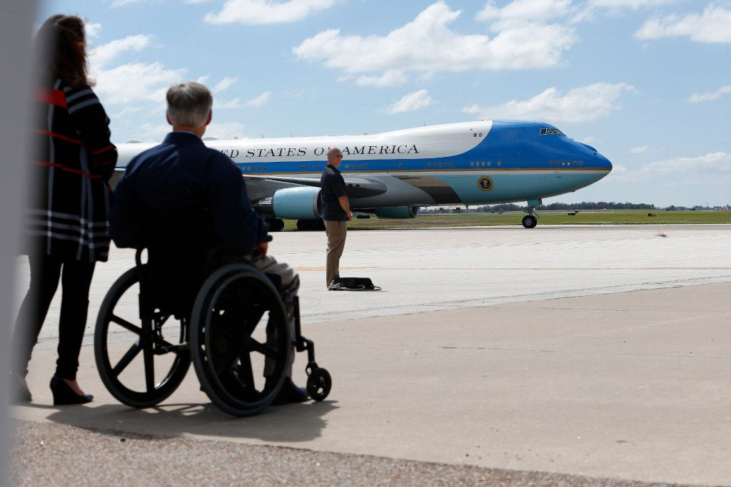 Texas Gov. Greg Abbot waits for Air Force One to land to greet President Donald Trump after Hurricane Harvey in Corpus Christi
