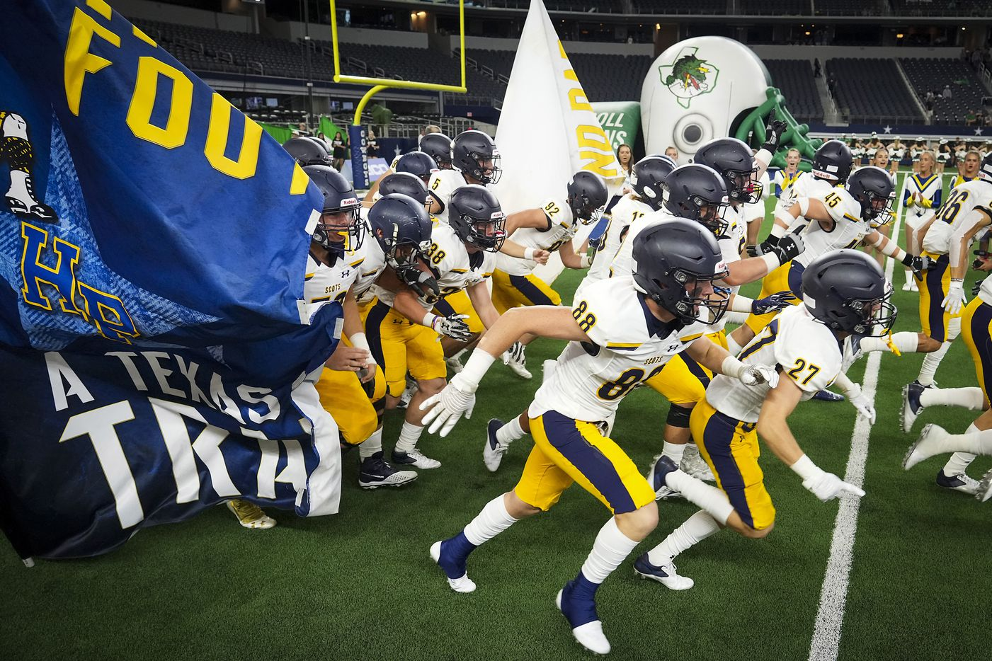 Highland Park players take the field to face Southlake Carroll in a high school football game at AT&T Stadium on Thursday, Aug. 26, 2021, in Arlington.