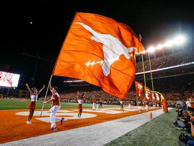 Longhorns cheerleaders bolt through the end zone after a Texas touchdown during the fourth quarter of a college football game between the University of Texas and Louisiana State University on Saturday, Sept. 7, 2019 at Darrell Royal Memorial Stadium in Austin, Texas.