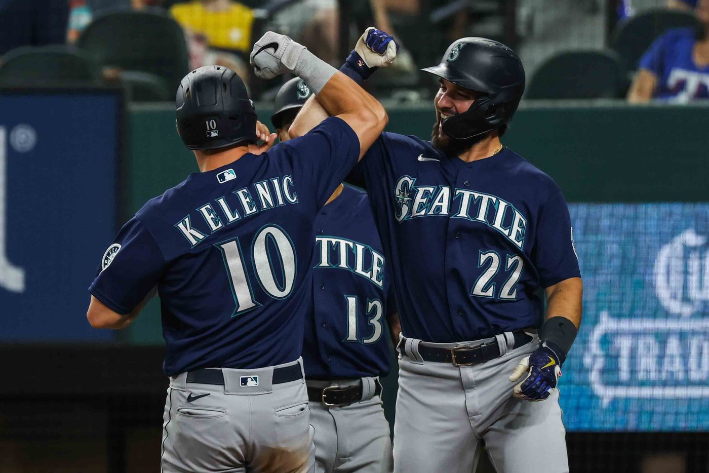 Seattle Mariners Dylan Moore (10) celebrates his homerun with Tom Murphy (22) in the third inning against the Texas Rangers at Globe Life Field in Arlington, Texas, Friday, July 30, 2021. (Lola Gomez/The Dallas Morning News)