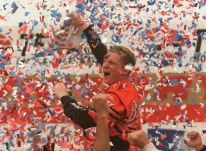 Driver Dale Earnhardt Jr. celebrates after winning his first Winston Cup race at the Direct TV 500 at the Texas Motor Speedway Sunday.