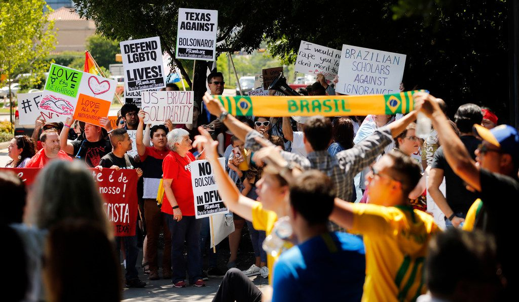 Protesters and supporters of Brazil's controversial president, Jair Bolsonaro, lined  the Old Parkland Hospital entrance on Maple Avenue in Dallas ahead of his event hosted by the World Affairs Council of Dallas/Fort Worth in May. Bolsonaro is a far-right-wing firebrand who has drawn fire from environmental, human rights and LGBTQ activists for his stances and statements.