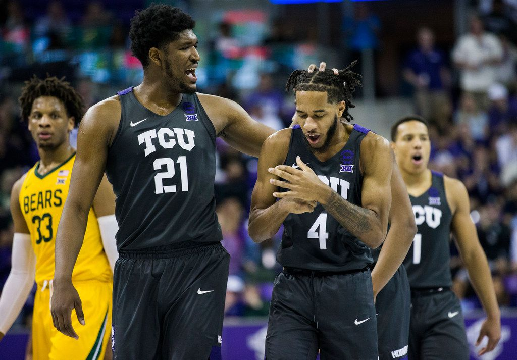 TCU Horned Frogs center Kevin Samuel (21) rubs the head of guard PJ Fuller (4) after a foul call during the second half of an NCAA mens basketball game between Baylor and TCU on Saturday, February 29, 2020 at Ed & Rae Schollmaier Arena on the TCU campus in Fort Worth. (Ashley Landis/The Dallas Morning News)