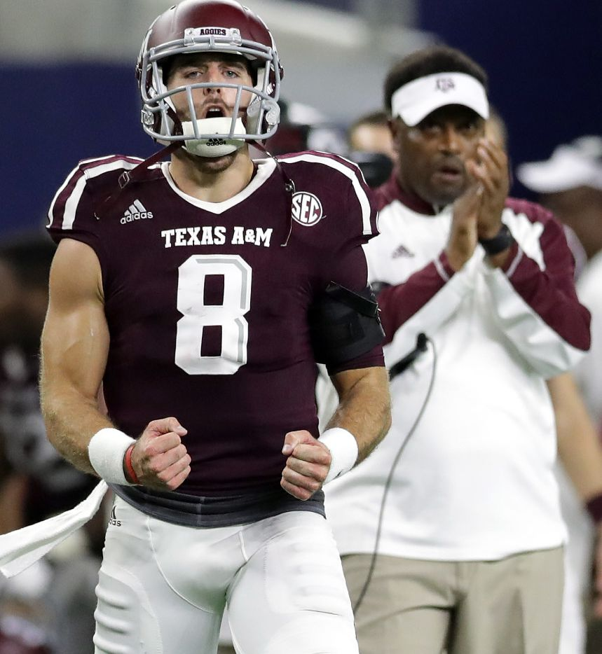 Texas A&M quarterback Trevor Knight  celebrates a touchdown against Arkansas in the fourth quarter at AT&T Stadium on Sept.24, 2016 in Arlington.