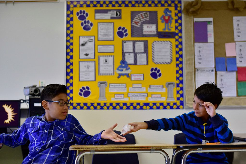 Alexis Solorzano (left) is handed a prop called a talking piece from Serjio Gallegos Escobedo as the sixth-graders participate in a Restorative Class, also known as circling by students, at Gaston Middle School in Dallas. The dialogue circles are used for students to talk about their feeling and issues in and out of class. (Ben Torres/Special Contributor)