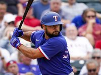 Texas Rangers infielder Isiah Kiner-Falefa bats during a spring training game against the Los Angeles Angels at Tempe Diablo Stadium on Friday, Feb. 28, 2020, in Tempe, Ariz.