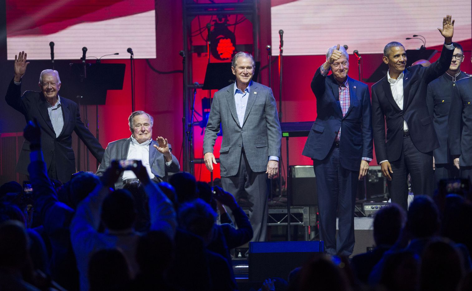 Former presidents Jimmy Carter, George H. W. Bush, George W. Bush, Bill Clinton and Barack Obama wave to audience members during Deep from the Heart: The One America Appeal Concert.