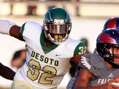 FILE - DeSoto defensive lineman Shemar Turner (32) chases down Bishop Dunne quarterback Simeon Evans (1) during a game at Sprague Stadium in Dallas on Saturday, Sept. 14, 2019.