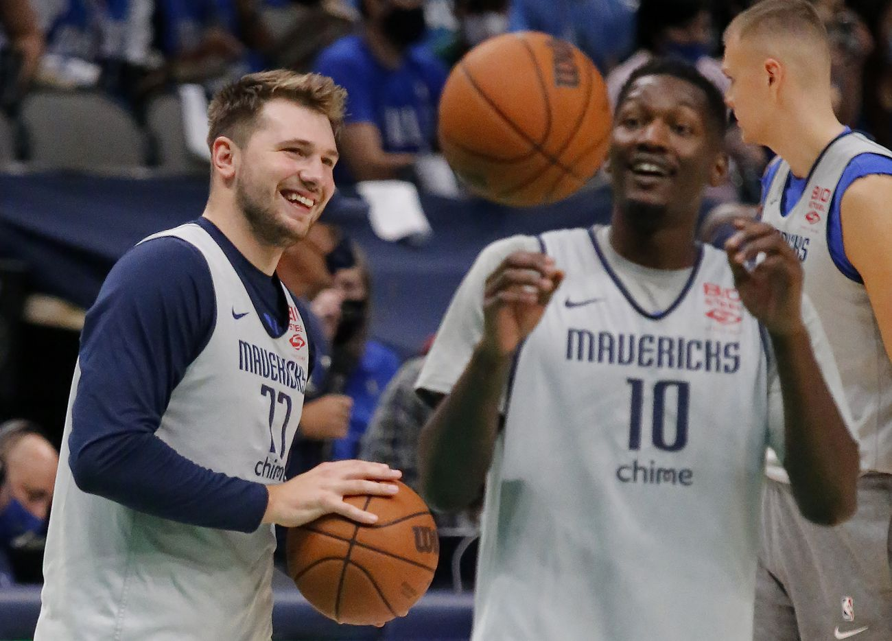 Dallas Mavericks guard Luka Doncic (77) shares a laugh with Dallas Mavericks forward Dorian Finney-Smith (10) during warm ups as the Dallas Mavericks held their Mavs Fam Jam, a scrimmage free to the public at the American Airlines Center in Dallas on Sunday, October 3, 2021. (Stewart F. House/Special Contributor)