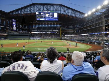 Texas Rangers fans for the first time take in an evening exhibition game at Globe Life Field in Arlington, Texas. The Rangers were playing the Milwaukee Brewers in an exhibition game, Monday, March 29, 2020.