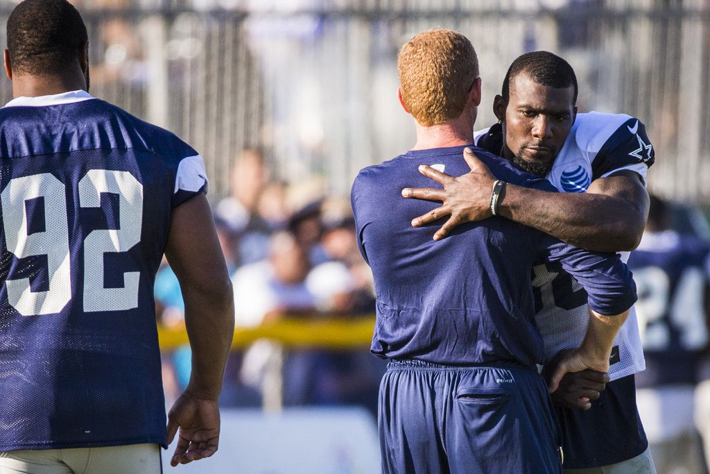 Dallas Cowboys head coach Jason Garrett hugs wide receiver Dez Bryant (88) after practice as defensive end Jeremy Mincey (92) looks on at training camp on Sunday, Aug. 2, 2015, in Oxnard, Calif. (Smiley N. Pool/The Dallas Morning News)