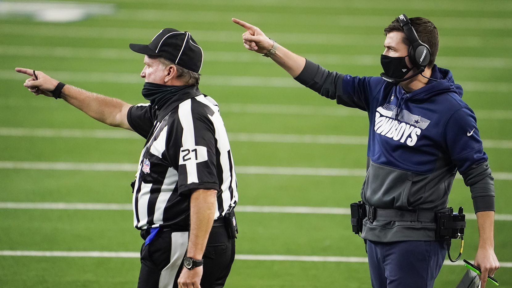 Cowboys offensive coordinator Kellen Moore looks for a call during the fourth quarter of a game against the Washington Football Team at AT&T Stadium on Thursday, Nov. 26, 2020, in Arlington.