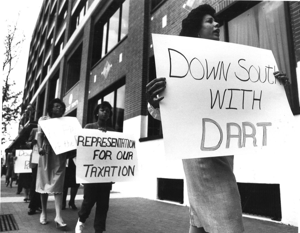 Bonnita Hargis carries her sign and shouts her feelings about the way DART does not provide enough buses to the minority community in 1986.