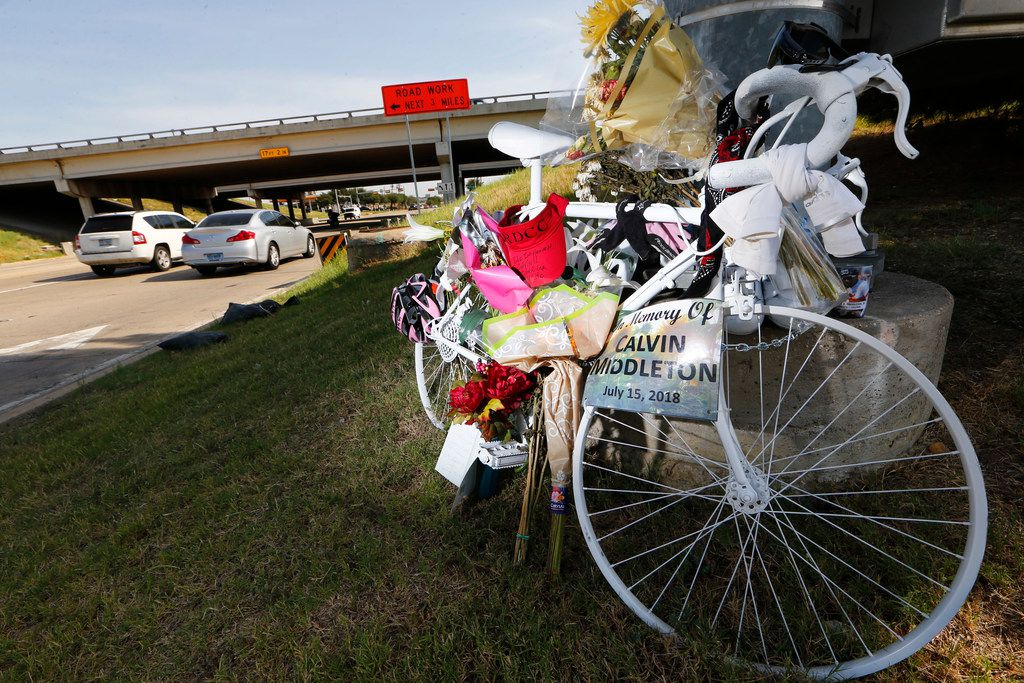 A ghost bike sits at the south east corner of Belt Line Road and Interstate 20 where Calvin Middleton of Cedar Hill was killed on his early morning ride in Grand Prairie.
